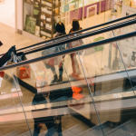 Woman in sunglasses going up an escalator for social media marketing feature for IJL Insider Blog