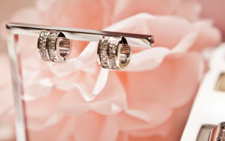 Jewellery Industry Trends 2018 diamond hoop earrings, bracelets and rings on a pale pink rose background