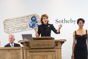 Caroline Lang, Chairman of Switzerland auctioneering the Farnese Blue