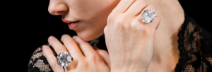 Geneva Diamond and Gemstone Auctions - Woman wears two 50 carat diamonds - Royal Wedding Meghan Markle
