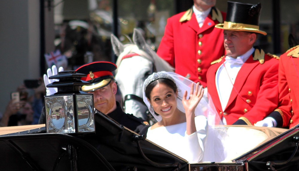 The Royal Wedding of Prince Harry and Meghan Markle Duke and Duchess of Sussex - Driving in the carriage through Windsor waving at crowds