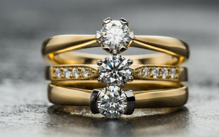 Yellow Gold engagement rings stacked together - IJL 2018 gold prices